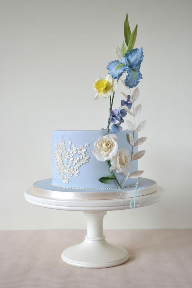 Pale blue single tier wedding cake with statement sugar flower arrangement and sugar sequins
