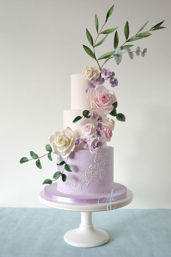 ivory and lilac floral wedding cake