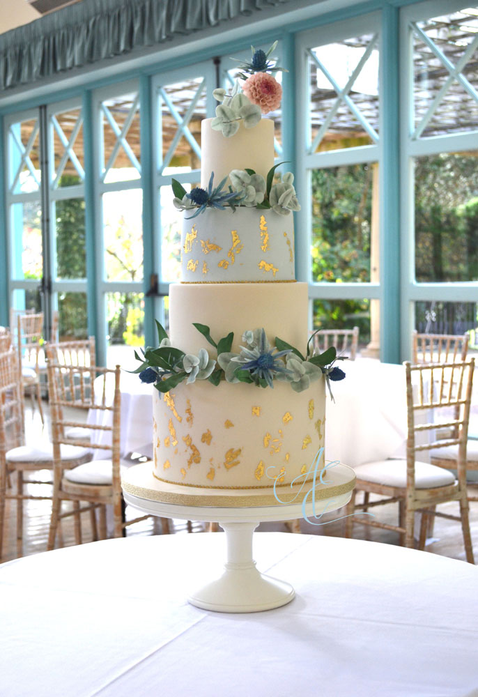 botanical and gold wedding cake in situ at the sun pavilion harrogate