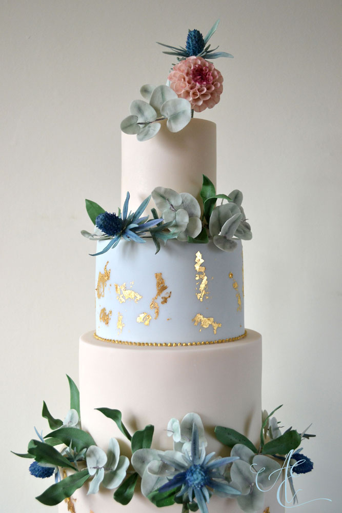 botanical and gold leaf wedding cake close up