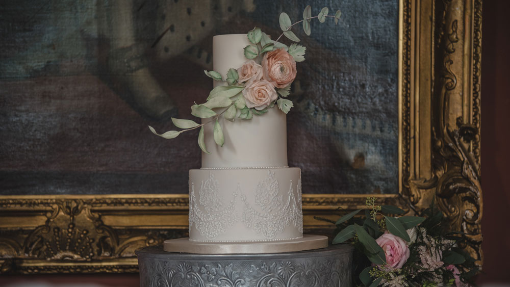 Lace and pastel floral wedding cake