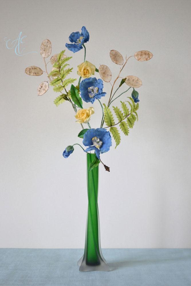 sugar poppy fern rose and lunaria arrangement