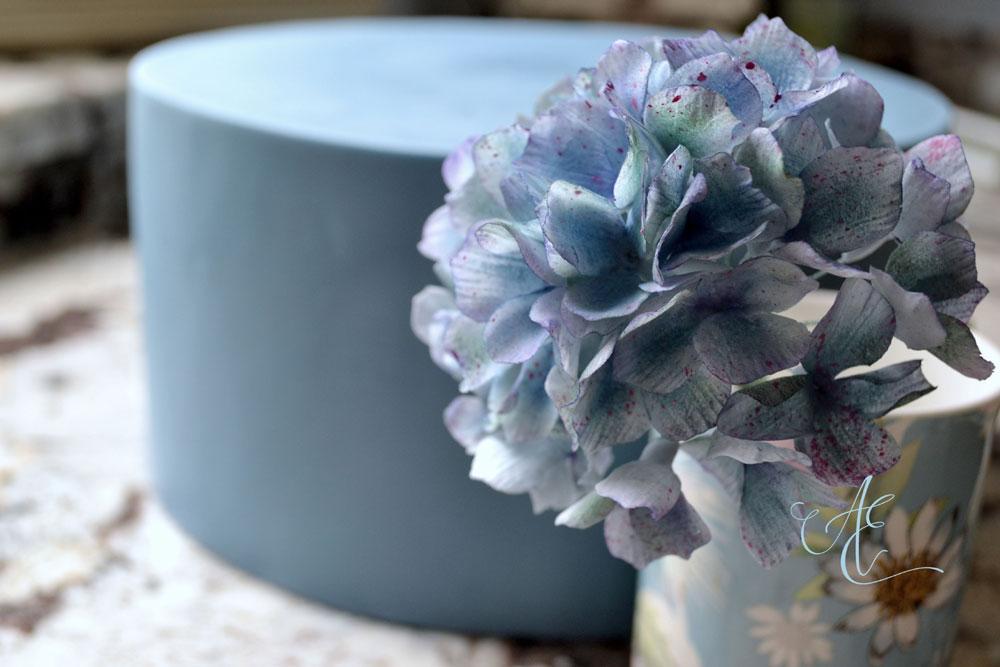 new wedding cake design blue tier and sugar hydrangea