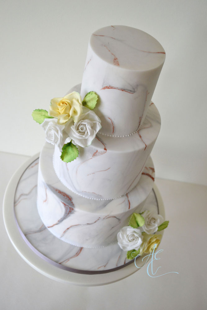 grey white copper marble and rose wedding cake aerial view