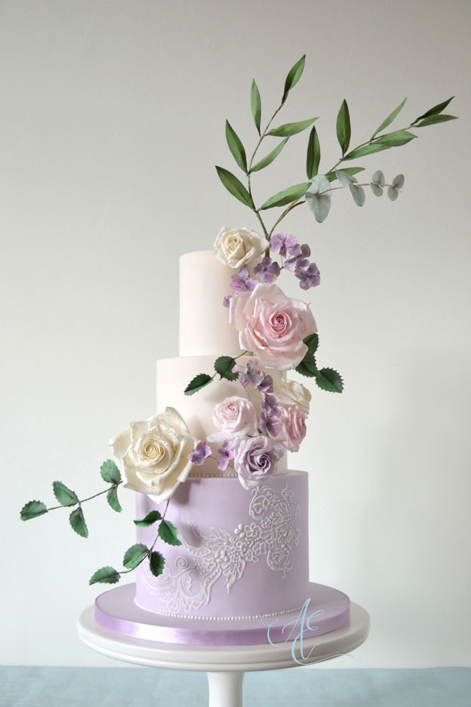 ivory and lilac floral and lace wedding cake