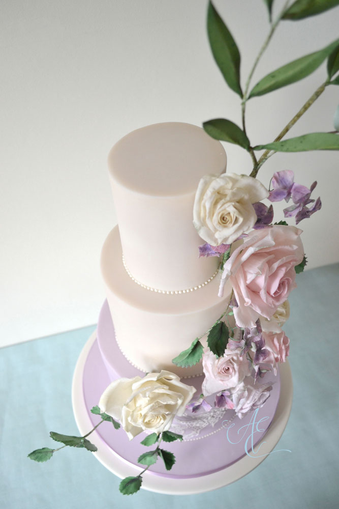 ivory and lilac floral wedding cake aerial shot left