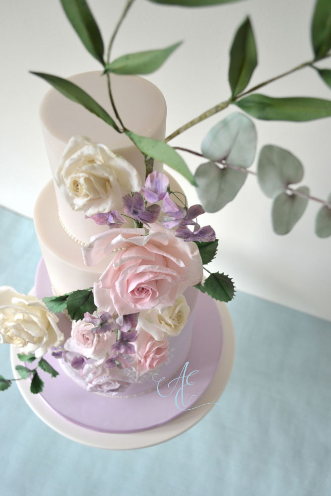 ivory and lilac floral wedding cake aerial shot right
