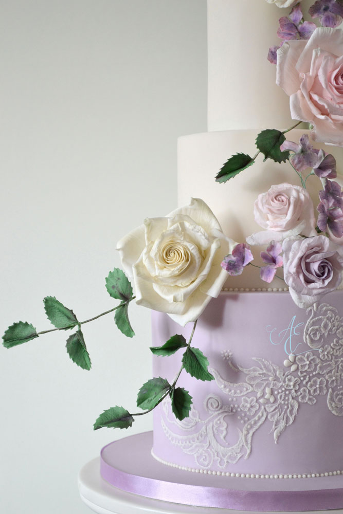 close up lilac and lace wedding cake tier