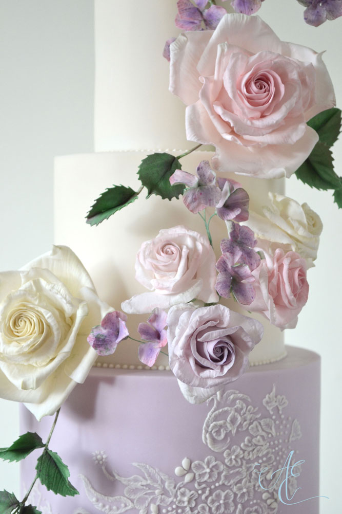 close up pink ivory and lilac sugar roses and hydrangea