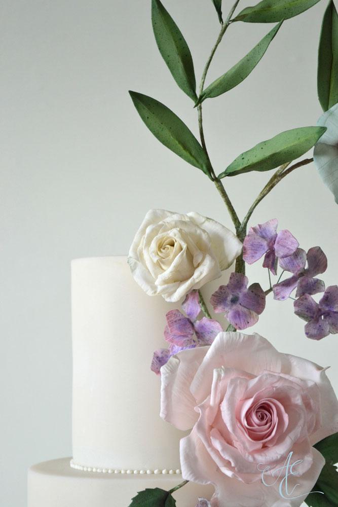 close up sugar roses hydrangea and foliage