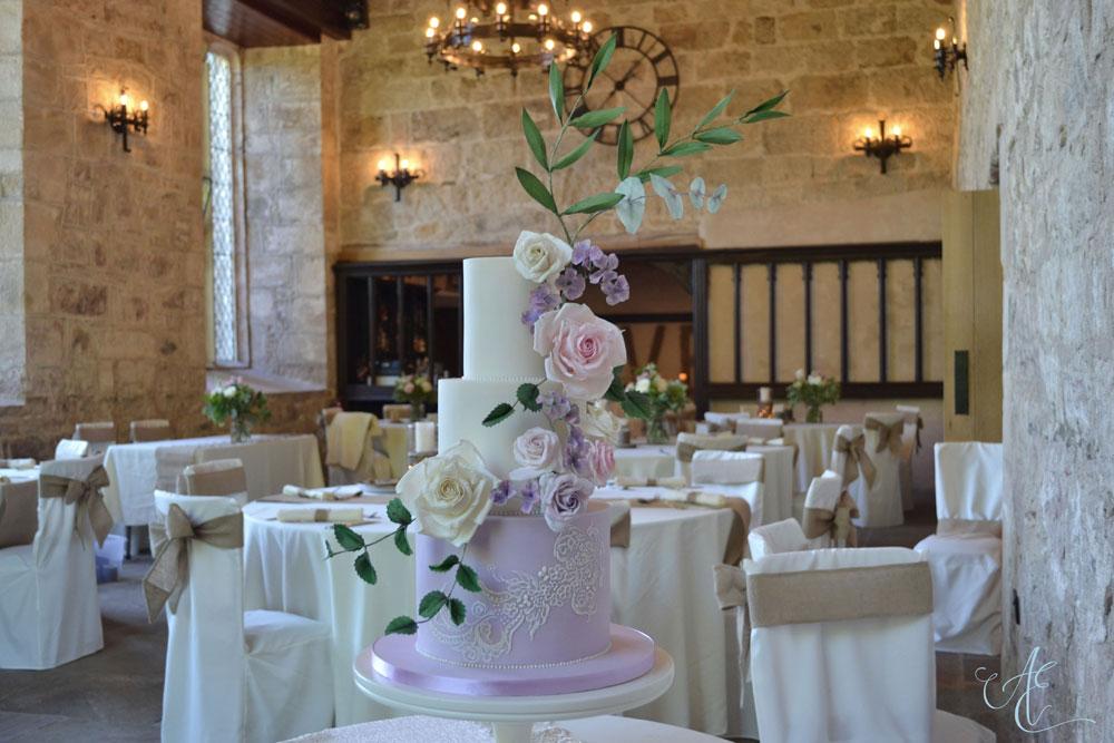 floral wedding cake on display priests house closer