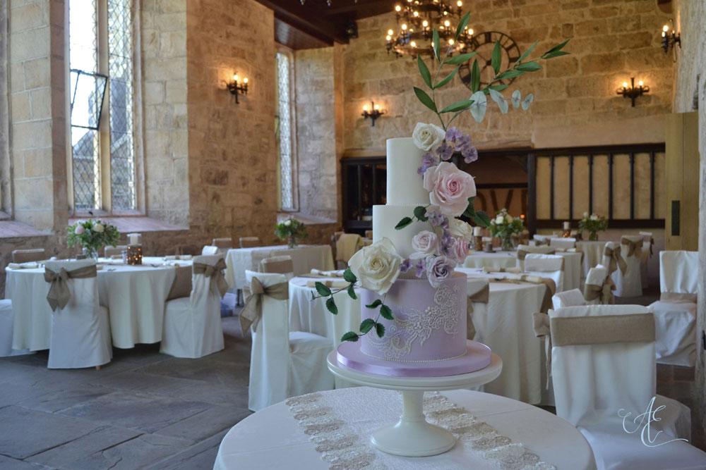 floral wedding cake on display priests house
