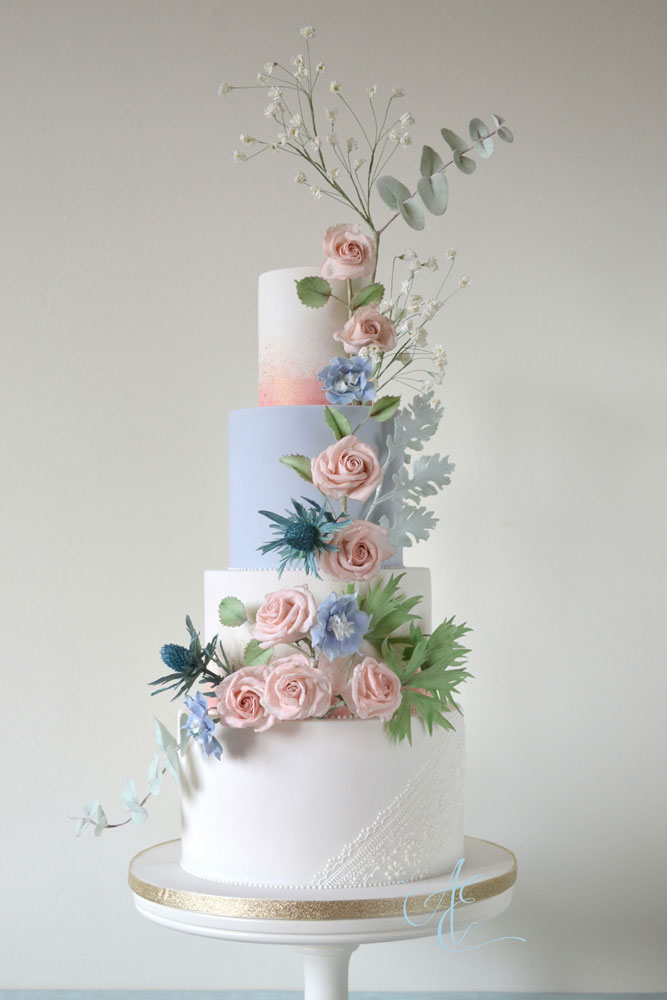 blush and blush wedding cake with sugar flower cascade tithe barn wedding