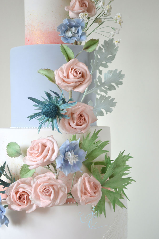 blush and blue floral wedding cake close up