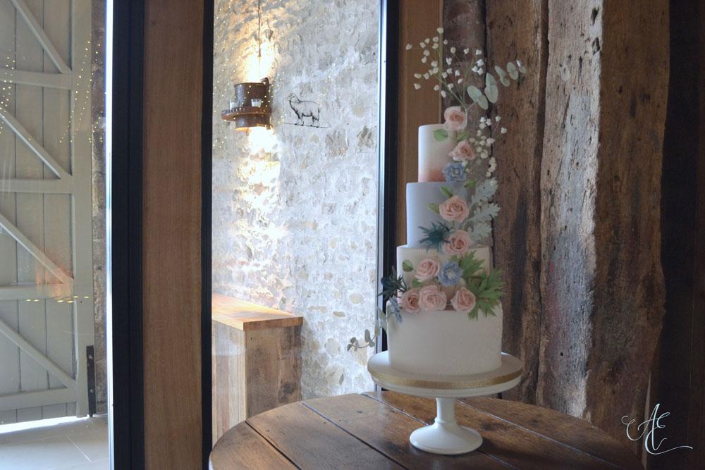 blush and blue wedding cake in situ tithe barn wedding