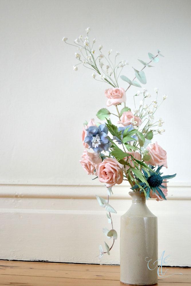 vase of sugar rose delphinium sea holly